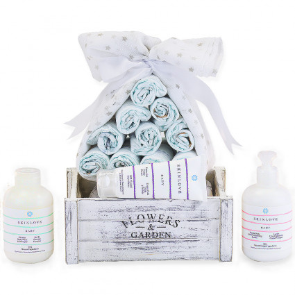 Pack of nappies with natural beauty products for babies